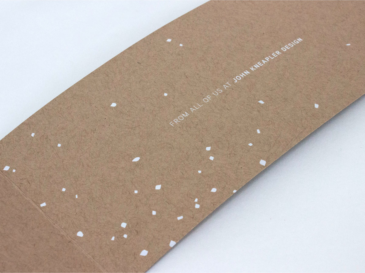 white foil stamping on natural paper snow themed holiday card
